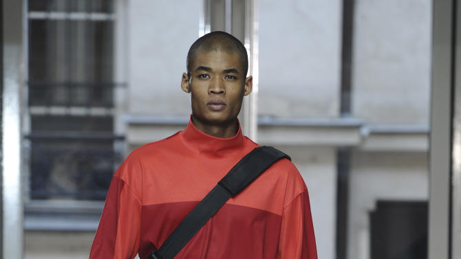 A model presents a creation for Issey Miyake fall-winter 2013/2014 men's fashion collection, presented in Paris, Thursday, Jan.17, 2013. (AP Photo/Zacharie Scheurer)