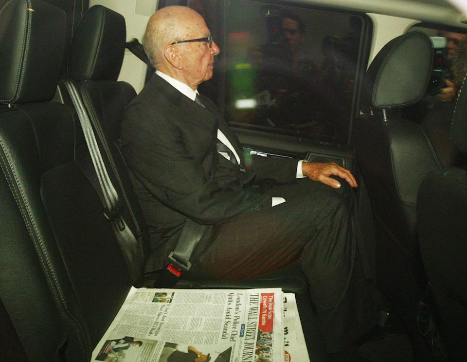 Rupert Murdoch leaves his London home  Monday July 18, 2011.  Murdoch and his son James Murdoch are to be grilled by a parliamentary committee of British lawmakers Tuesday over the phone hacking  scandal.  (AP Photo/Steve Parsons/PA) UNITED KINGDOM OUT