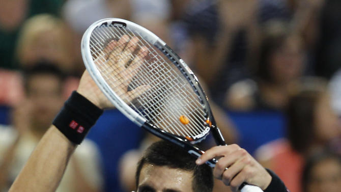 CORRECTS SCORE - Serbia's Novak Djokovic acknowledges a crowd after beating Spain's Fernando Verdasco 6-3, 7-5 in their men's final match at the Hopman Cup tennis tournament in Perth, Australia, Saturday, Jan. 5, 2013. (AP Photo/Theron Kirkman)