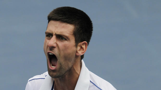 Novak Djokovic of Serbia reacts after winning a semifinal match against Roger Federer of Switzerland at the U.S. Open tennis tournament in New York, Saturday, Sept. 10, 2011. (AP Photo/Mike Groll)