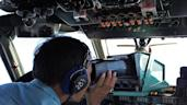 Picture taken on March 8, 2014 shows personnel scanning the sea aboard a Vietnamese Air Force aircraft taking part in a search mission for a missing Malaysia Airlines aircraft