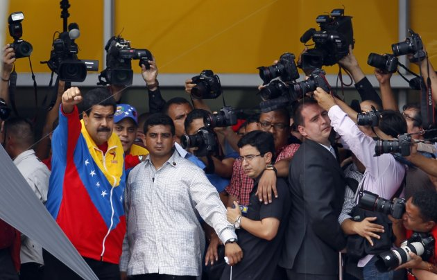 Venezuela's acting President Maduro gestures next to the media after he registered as candidate for president in the April 14th election outside the national election board in Caracas
