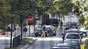 FBI agents investigate at the scene of the shooting inside the Washington Navy Yard in Washington