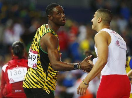 Gold medal winner Bailey-Cole shakes hands with silver medal winnier Gemili following the men's 100m final at the 2014 Commonwealth Games in Glasgow