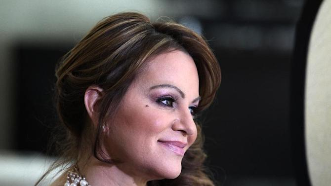 In this picture taken March 8, 2012, Mexican-American singer and reality TV star Jenni Rivera poses during an interview in Los Angeles. The California-born singer who rose through personal adversity to become a superstar adored by millions in a male-dominated genre of Mexican-American music, was confirmed dead in a plane crash in northern Mexico, the National Transportation Safety Board confirmed Monday, Dec. 10, 2012.  (AP Photo/Reed Saxon)