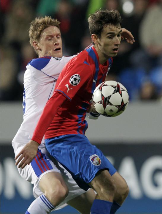 CSKA Moscow's Rasmus Elm challenges Viktoria Plzen's Tomas Horava during their Champions League soccer match in Plzen