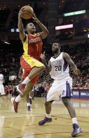 Lowry leads Rockets past Kings, 103-89