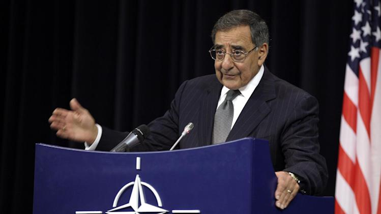 In this photo taken Oct. 10, 2012, Defense Secretary Leon Panetta speaks at NATO headquarters in Brussels. The US has sent troops to Jordan to bolster its military capabilities in the event Syria's civil war escalates, Panetta said Wednesday, reflecting U.S. concerns about the conflict spilling over allies' borders and about the security of Syria's chemical weapons arsenal. Speaking at a NATO conference of defense ministers, Panetta said the U.S. has been working with Jordan to monitor chemical and biological weapons sites in Syria and also to help Jordan deal with refugees pouring over the border from Syria.   (AP Photo/Virginia Mayo)
