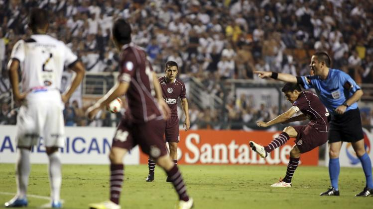 Goltz of Argentina's Lanus of Argentina's Lanus scores a goal against Brazil's Ponte Preta in their Copa Sudamericana first leg final soccer match in Sao Paulo