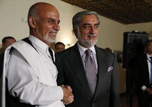 Afghanistan's presidential candidates Ghani and Abdulah shake hands after announcing a deal for the auditing of all Afghan election votes at the United Nations Compund in Kabul