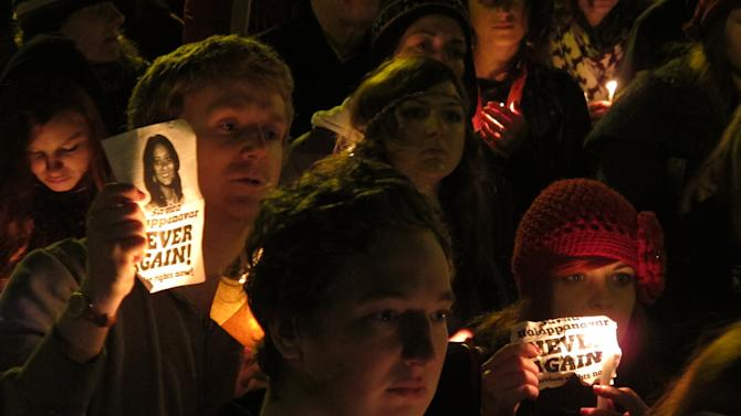 FILE - A Saturday, Nov. 17, 2012 photo from files showing abortion rights protesters hold candles and pictures in a vigil for Savita Halappanavar outside Ireland's government headquarters in Dublin. Ireland's prime minister says anti-abortion activists in the predominantly Catholic country have inundated his office with threatening packages and letters branding him a murderer, some written in blood. Enda Kenny made the declaration Wednesday, June 12, 2013, as his government prepared to publish a bill that would legalize abortions in exceptional cases where doctors deem the woman's life is in danger from continued pregnancy. Anti-abortion activists insist the proposed law would lead eventually to widespread abortion. (AP Photo/Shawn Pogatchnik, File)