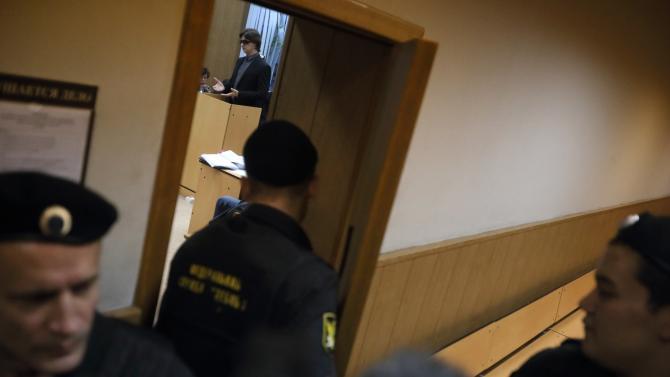 Artistic director of the Bolshoi ballet Sergei Filin testifies in Moscow's court, behind an open door, on Wednesday, Nov. 6, 2013. Filin, is to testify in court Wednesday against ballet soloist Pavel Dmitrichenko and his suspected accomplices, after Filin was attacked with acid in January 2013 and left with severe burns to his face and eyes which impaired his vision. (AP Photo/ Pavel Golovkin)