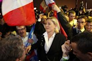French far right party Front National (FN) candidate Marine Le Pen dances with her supporters during the election night rally of her party on the evening of the first round of the 2012 French Presidential election on April 22. French President Nicolas Sarkozy has ruled out any pact with Le Pen's National Front after its electoral breakthrough