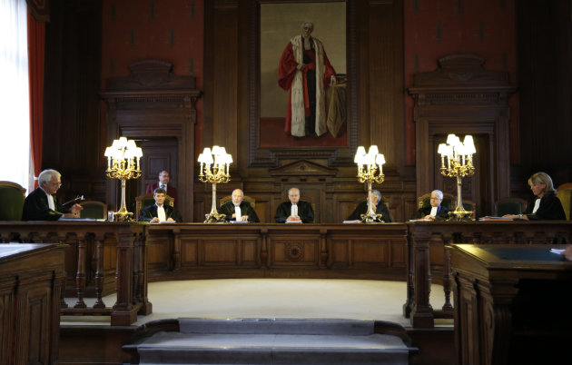 Judge Albert Fettweis, centre, presides over a hearing for Michelle Martin at the Court of Cassation at the Justice Palace in Brussels on Tuesday, Aug. 28, 2012. The highest court is considering whether to grant conditional early release to one of the nation's most despised criminals even though the accomplice and former wife of a pedophile and child killer let two of his victims starve to death. The Court of Cassation said Tuesday it can only rule on procedural issues in the decision by a lower court to allow Michelle Martin to go live in a convent after serving barely half of her 30-year sentence for her part in the mid-1990s kidnappings, rapes and killings of Marc Dutroux. (AP Photo)