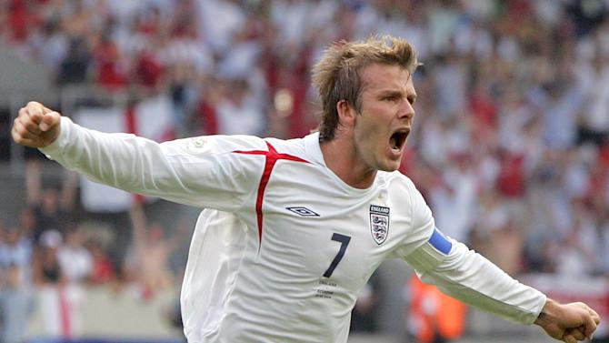 FILE - In this June 25, 2006 file photo, England's David Beckham celebrates after scoring the opening goal during the Round of 16 World Cup soccer match against Ecuador in Stuttgart, Germany. Beckham says he is retiring from soccer at the end of the season. The 38-year-old Beckham recently won a league title in a fourth country with Paris Saint-Germain. He has become a global superstar since starting his career at Manchester United. (AP Photo/Matt Dunham, FIle)