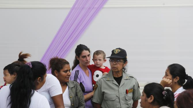 Spanish inmate Gracia Bordes, 28,  and her son Jairo participate in an event ahead of the International Women's Day at Santa Monica female prison in Lima
