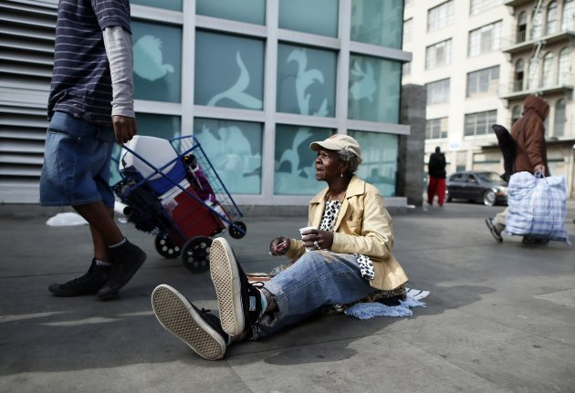 A woman sits on downtown Los Angeles' Skid Row