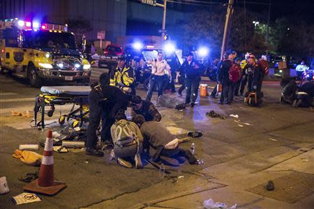 A victim who was struck by a vehicle on Red River Street during the SXSW festival is assisted in downtown Austin
