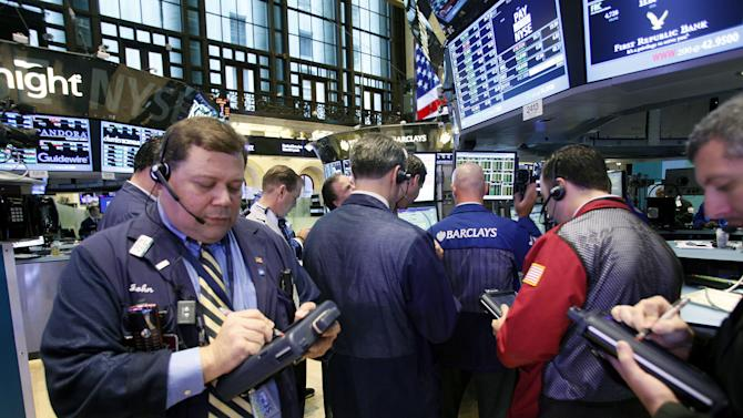 Traders and Specialists work the trading floor of the New York Stock Exchange after the opening bell, on Thursday, Sept. 6, 2012.  (AP Photo/David Karp)