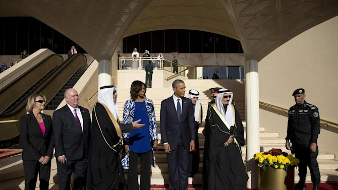 President Barack Obama and first lady Michelle Obama stand with Saudi King Salman bin Abdul Aziz in a receiving line on arrival to King Khalid International Airport, in Riyadh, Saudi Arabia, Tuesday, Jan. 27, 2015. The president came to expresses condolences on the death of the late Saudi Arabian King Abdullah bin Abdulaziz al-Saud. (AP Photo/Carolyn Kaster)