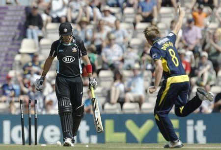 Hampshire Royals' Dawson celebrates as Surrey Lions' Pietersen is bowled out during their match at Hampshire Ageas Bowl in Southampton