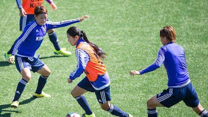 Japan's Homare Sawa (C) tries to keep the ball from her teammates during their FIFA Women's World Cup training session in Edmonton, Canada on June 28, 2015