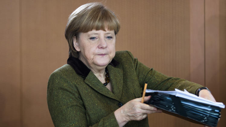 German Chancellor Angela Merkel arrives for the weekly cabinet meeting at the chancellery in Berlin, Wednesday, March 13, 2013. The cabinet will discuss Germany's budget for  2014. (AP Photo/Markus Schreiber)
