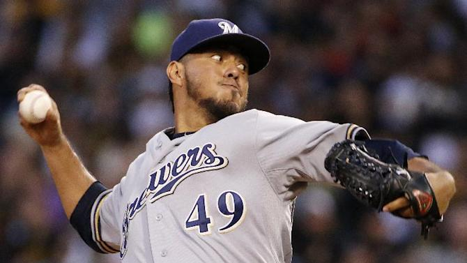 Milwaukee Brewers starting pitcher Yovani Gallardo delivers during the first inning of a baseball game against the Pittsburgh Pirates in Pittsburgh on Friday, Sept. 19, 2014. (AP Photo/Gene J. Puskar)
