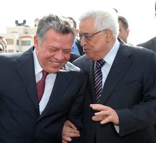 Palestinian President Mahmoud Abbas speaks with Jordan's King Abdullah upon his arrival in the West Bank city of Ramallah