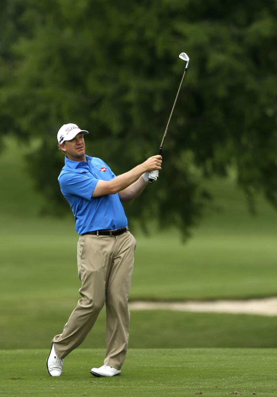 Tom Gillis follows his shot off the fourth fairway during the second round of the Byron Nelson Championship golf tournament Friday, May 17, 2013, in Irving, Texas. (AP Photo/Tony Gutierrez)