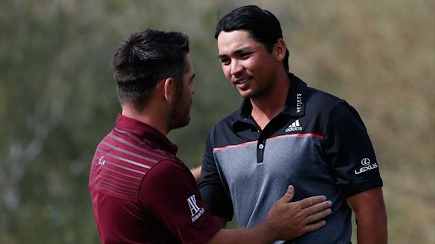Jason Day of Australia (R) shakes hands with Louis Oosthuizen of South Africa (AFP)