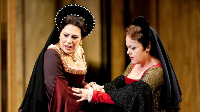 "This undated handout photo provided by the Washington National Opera shows Sondra Radvanovsky as Anne Boleyn, left, and Sonia Ganassi as Jane Seymourin a scene from ""Anna Bolena."" (AP Photo/Scott Suchman, Washington National Opera)"