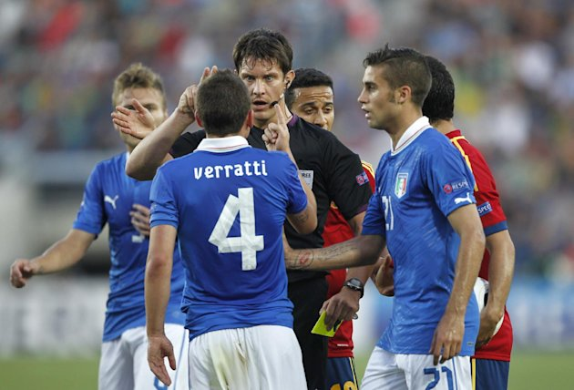 Italian players crowd around referee Matej Jug of Slovenia during the final of the European U21 Soccer Championship match against Spain in Jerusalem, Tuesday, June 18, 2013