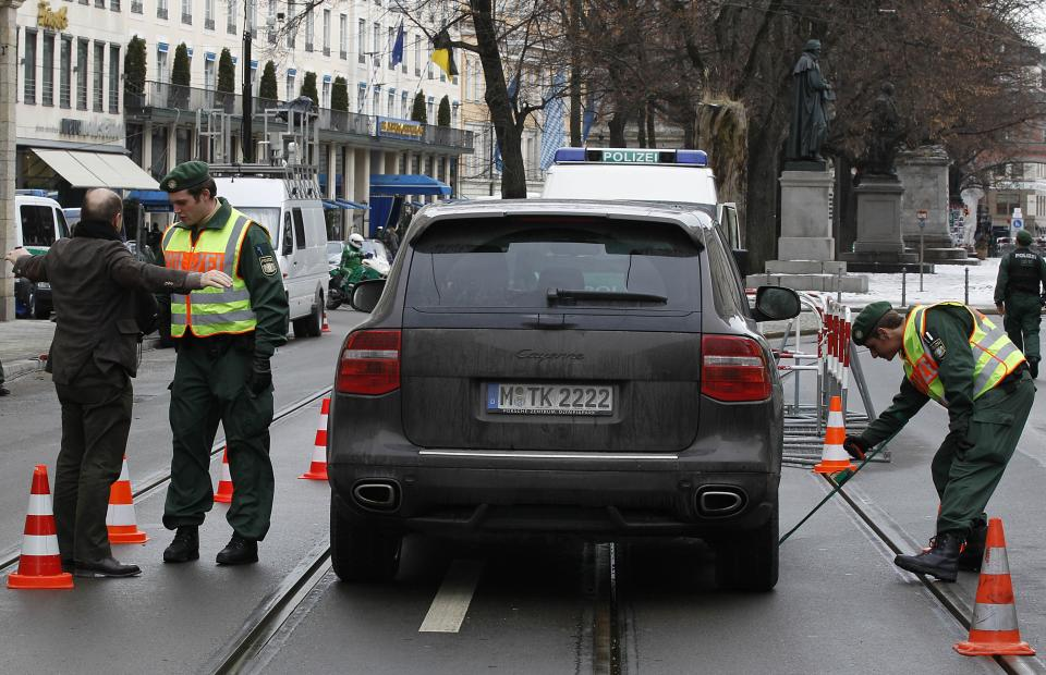 Special police forces check cars in front of the Hotel 'Bayrischer Hof'  prior to the Conference on Security Policy in Munich, Germany, Friday, Feb. 4, 2011.   (AP Photo/Frank Augstein)