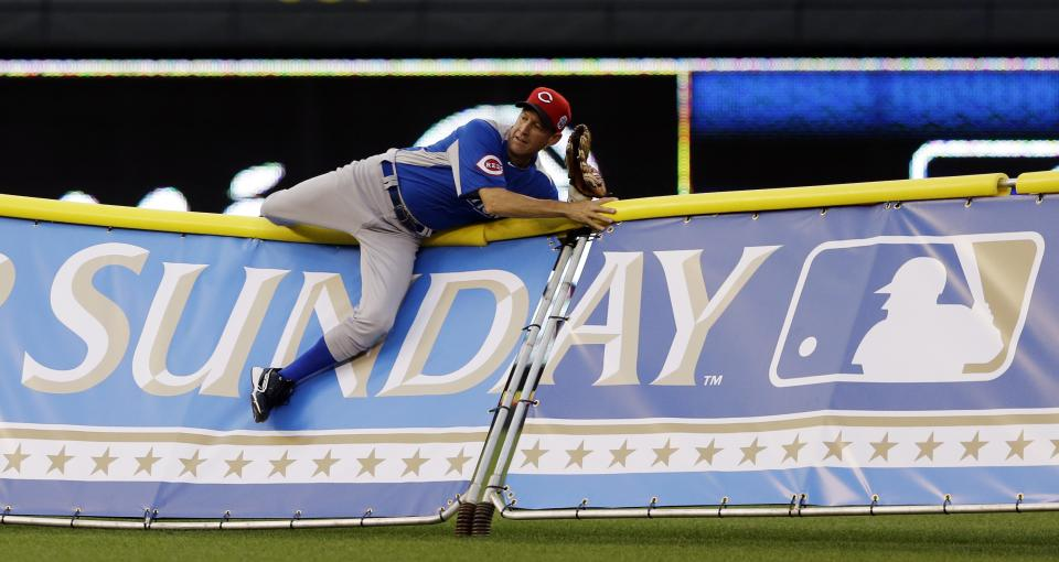 Actor James Denton tries to make a diving catch during the MLB All-Star celebrity softball game, Sunday, July 8, 2012, in Kansas City, Mo. (AP Photo/Charlie Riedel)