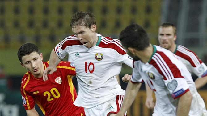 Belarus player Aleksandr Hleb, center, passes beside Macedonia's player Enis Bardi, left, during their Group C, Euro 2016 qualifying soccer match, at the Philip II stadium, in Skopje, Macedonia, Friday, March 27, 2015. (AP Photo/Boris Grdanoski)