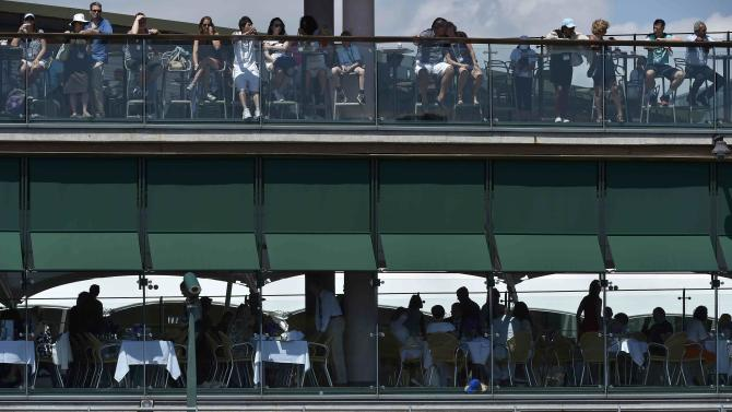 Spectators on Court 3 at the Wimbledon Tennis Championships in London