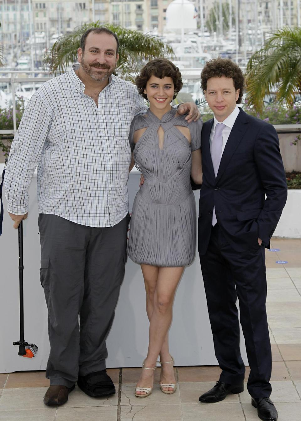 Actors Hernan Mendoza, left, Tessa La Gonzales and director Abbas Kiarostami pose during a photo call for After Lucia at the 65th international film festival, in Cannes, southern France, Monday, May 21, 2012. (AP Photo/Francois Mori)