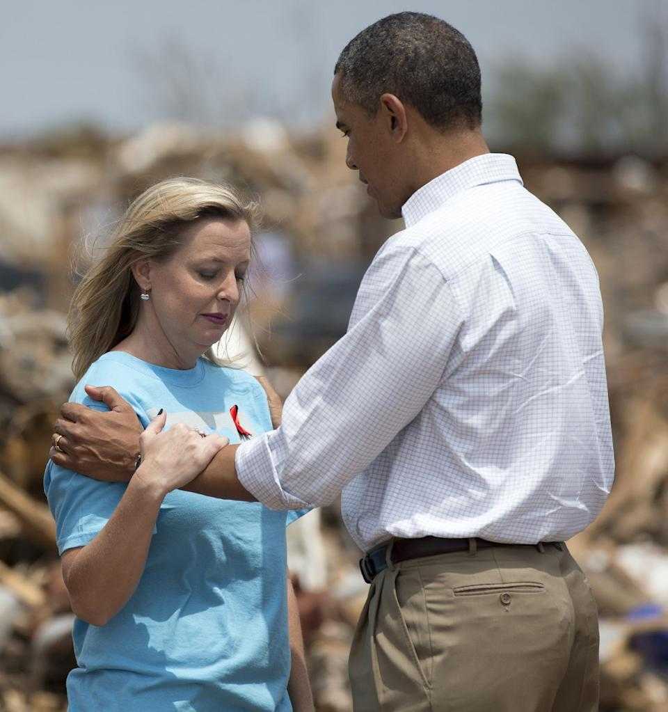 President Barack Obama tries to comfort Plaza Towers Elementary School principal Amy Simpson Sunday May 26, 2013, in Moore, Okla., as he views the devastation of the school caused by tornado and severe weather last week.  (AP Photo/Carolyn Kaster)