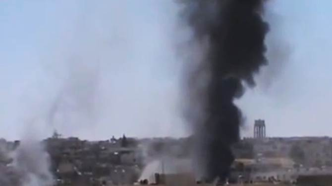 This image made from amateur video released by the Ugarit News and accessed Tuesday, June 19, 2012, purports to show black smoke rising from buildings in Rastan town, Homs, Syria. Syria's government said Tuesday it was ready to act on a U.N. call to evacuate civilians trapped in the rebellious central city of Homs for more than a week, but blamed rebels for obstructing efforts to get them out. (AP Photo/Ugarit News via AP video) TV OUT, THE ASSOCIATED PRESS CANNOT INDEPENDENTLY VERIFY THE CONTENT, DATE, LOCATION OR AUTHENTICITY OF THIS MATERIAL