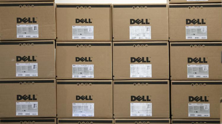 FILE- In this Aug. 16, 2008, file photo, boxes containing Dell computers are stacked on an upper shelf of a Best Buy store in Seekonk, Mass. Computer maker Dell Inc. annoucned Wednesday, June 13, 2012, that it is planning more than $2 billion in cost cuts over the next three years as its looks to transform its business so it can keep pace in the highly competitive technology sector.  (AP Photo/Stew Milne)