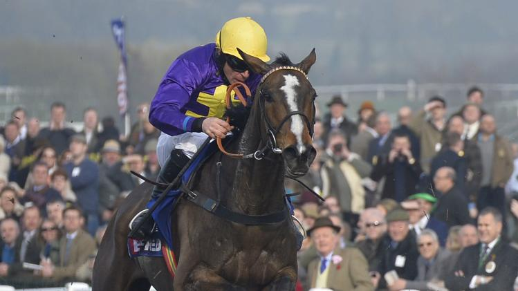 Jockey Russell riding Lord Windermere clears the final fence on the way to winning the Gold Cup at the Cheltenham Festival horse racing meet in Gloucestershire, western England