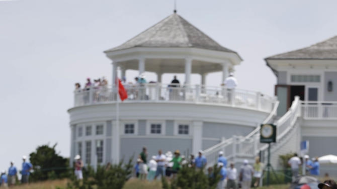 Fans watch action on the ninth hole during the first round at the U.S. Women's Open golf tournament at Sebonack Golf Club in Southampton, N.Y., Thursday, June 27, 2013. (AP Photo/Seth Wenig)