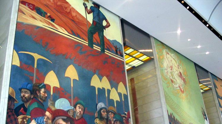 This undated image provided by Visit Charlotte shows frescoes painted by Ben Long in the Bank of America Corporate Center in Charlotte, N.C. Long who studied fresco painting in Italy before bringing the art to churches in his home state of North Carolina and the three-panel bank painting was his first secular fresco. (AP Photo/Visit Charlotte)
