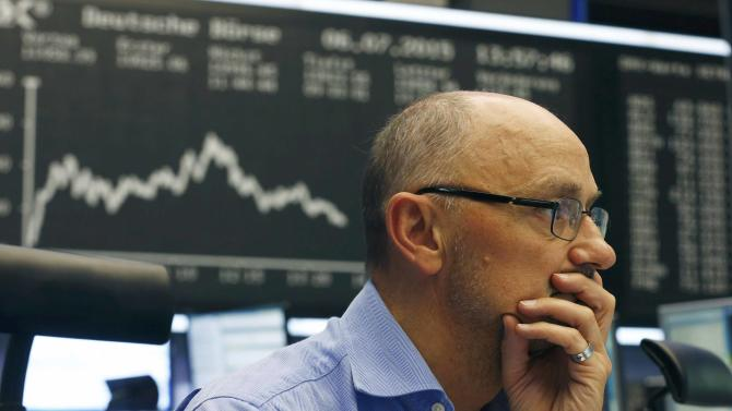 A trader works at the Frankfurt stock exchange