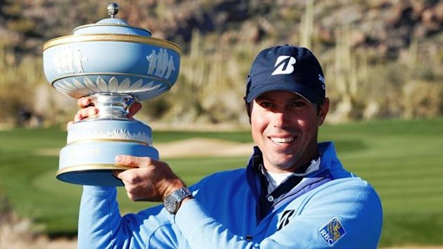 American golfer Matt Kuchar holds his Match Play Championship trophy in Marana, Arizona (Reuters)