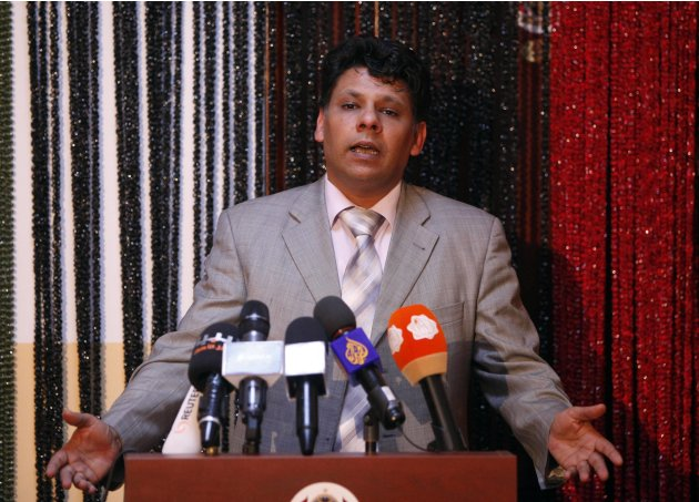 Al Sadiq al-Sour, an official from Libya's prosecutor general office, speaks during a news conference in Tripoli