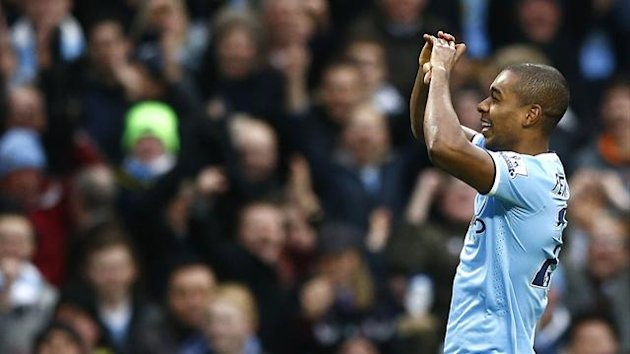 Fernandinho celebrates scoring for Manchester City against Arsenal (Reuters)