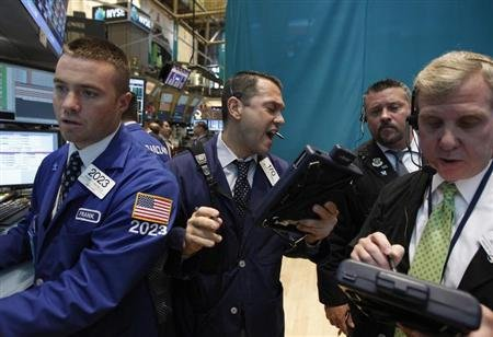 Traders work on the floor of the New York Stock Exchange June 11, 2012. REUTERS/Brendan McDermid