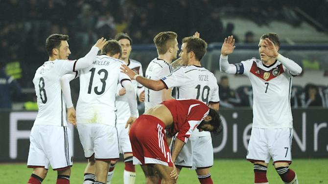 Germany players celebrate their victory during the Euro 2016 qualifying match between Germany and Georgia, in Tbilisi, Georgia, Sunday, March 29, 2015. (AP Photo/Shakh Aivazov)